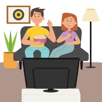 Paar, das popcorn isst und einen film sieht