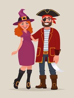 Paar feiern halloween. ein mann in einem piratenkostüm und eine frau, die als hexe auf einer maskerade-party verkleidet war