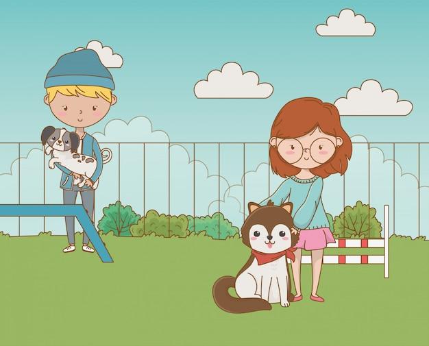 Paar jungen und mädchen mit hunden