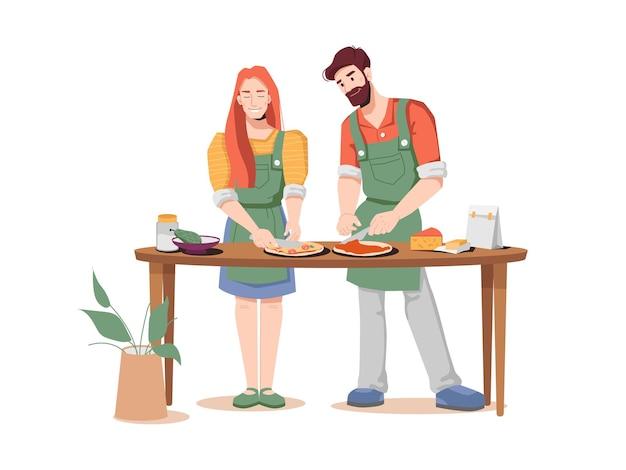 Paar mann und frau kochen zusammen pizza am tisch