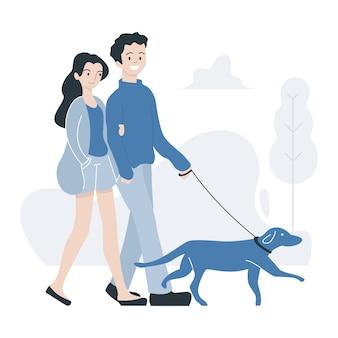 Paar mit hund spazieren