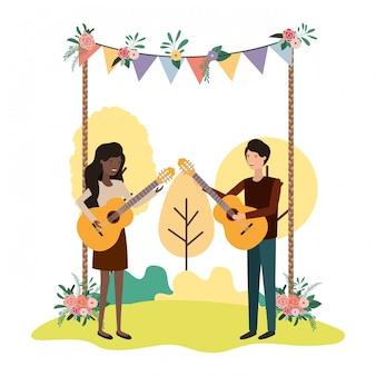 Paar mit musikinstrument in landschaft