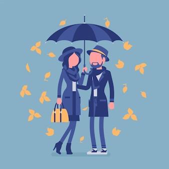 Paar mit regenschirm im herbst. mann, verliebte frau, die unter regen von gelben blättern geschützt zusammensteht und sich sicher, geborgen, romantische beziehung fühlt. vektorillustration, gesichtslose charaktere