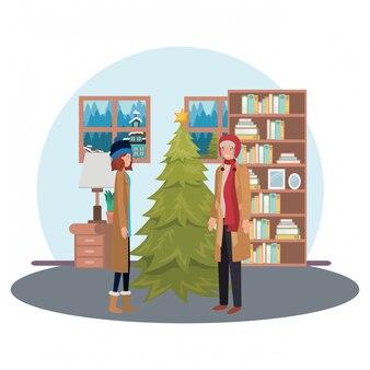 Paar mit weihnachtsbaum im wohnzimmer