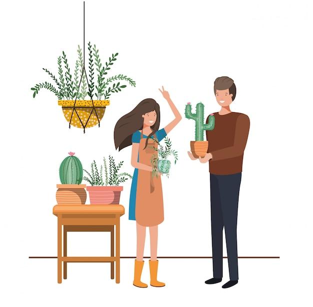 Paar mit zimmerpflanze auf makramee kleiderbügeln