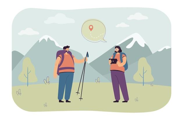 Paar-plotting-route zum wandern. ein paar wanderer mit tablet, die über die wanderung zum gipfel nachdenken.