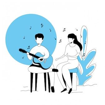 Paar singt mit gitarre