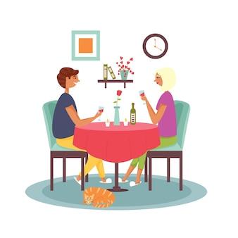 Paar sitzt am tisch und trinkt wein