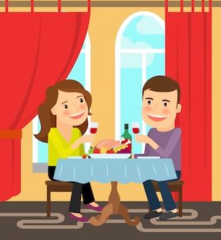 Paar sitzt am tisch zu feiern