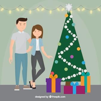 Paar szene neben dem weihnachtsbaum