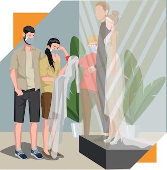 Paar wählen das brauthochzeitskleid im hochzeitskleidungsgeschäft