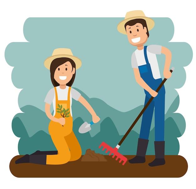 Paare der jungen gärtner, die gartenarbeitarbeit tun