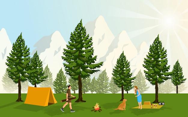 Paare, die in einem kiefernwald, mit den schneebedeckten bergen bedecken und funkelnden sonnenuntergängen als hintergrund kampieren