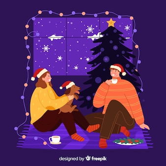 Paare, die zusammen auf einer weihnachtsnacht bleiben