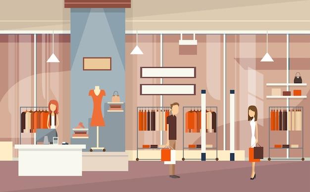 Paare mit einkaufstaschen-luxusmode-shop