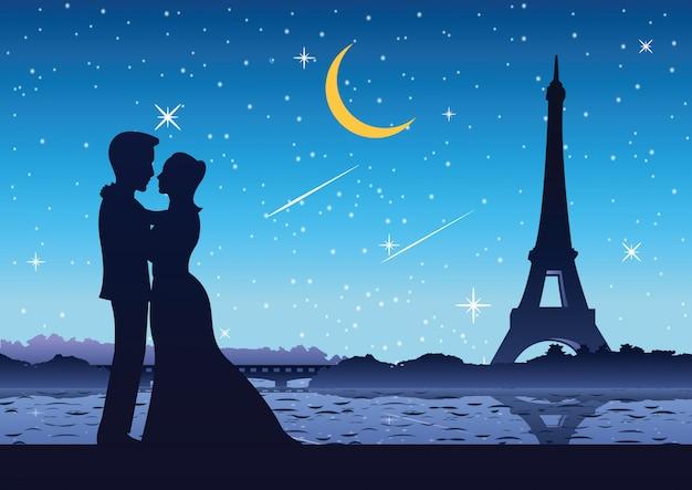 Paare stehen nahe fluss am eifelturm frankreich