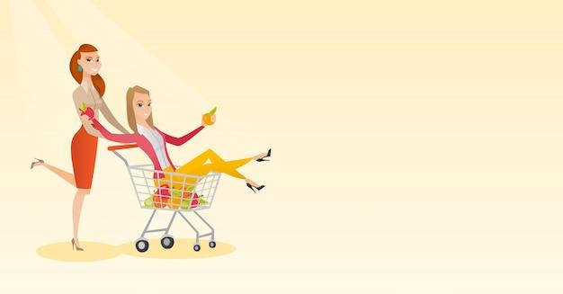 Paare von den freunden, die in einkaufslaufkatze fahren.