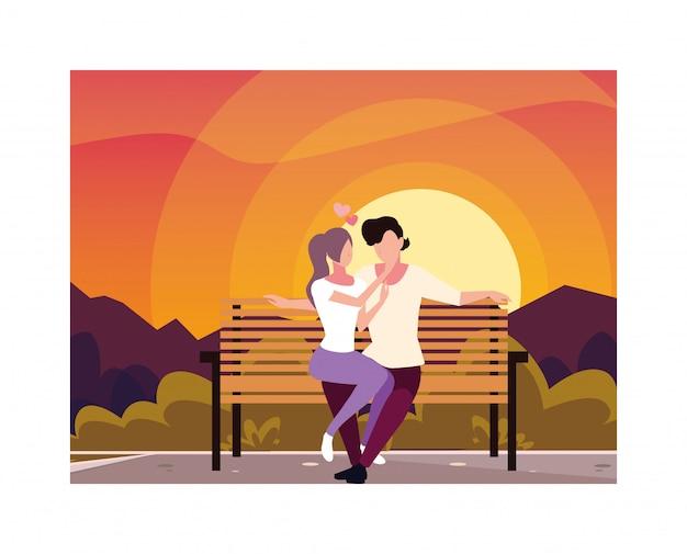 Paare von den verliebten leuten, die im parkstuhl sitzen