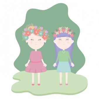 Paare von netten mädchen mit blumenkrone im haar auf dem gebiet