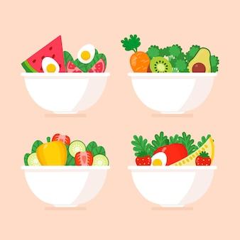 Packung mit gesunden obst- und salatschüsseln
