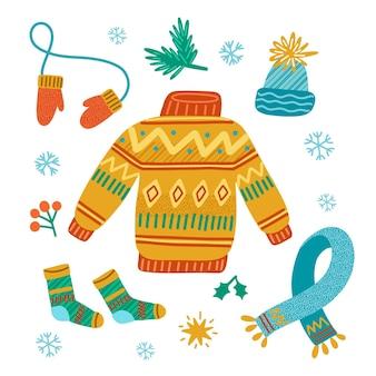 Packung mit gezeichneter winterkleidung