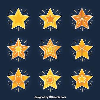Packung mit glänzenden sternen mit geometrischen mustern