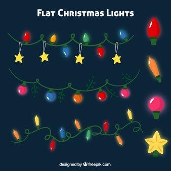 Packung mit glänzenden weihnachtsbeleuchtung in flaches design