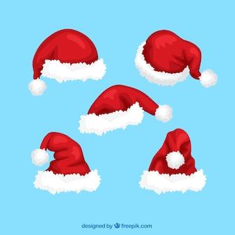 Packung mit handgezeichneten weihnachtsmann hüte