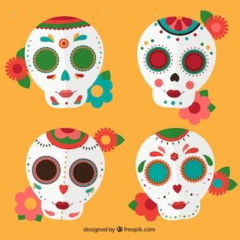 Packung mit mexikanischer schädel mit blumen