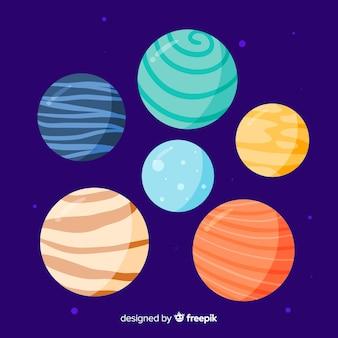 Packung mit niedlichen handgezeichneten planeten