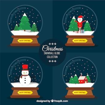 Packung mit vier schneebälle mit weihnachten elemente