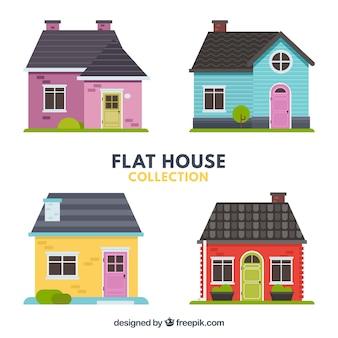 Packung mit vier schönen Häusern im flachen Design