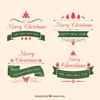 Packung mit vier weihnachtsabzeichen mit vintage-bänder