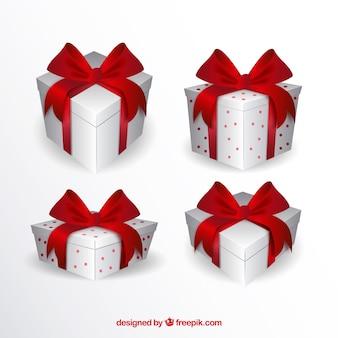 Packung mit weißen geschenkboxen mit roten bändern