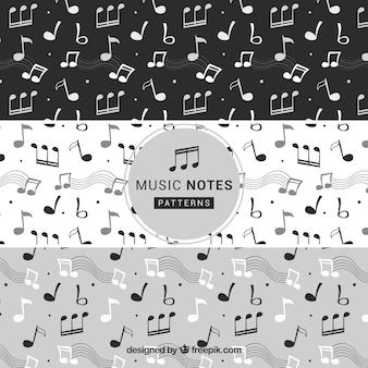 Packung musikalische notenmuster in schwarz und weiß