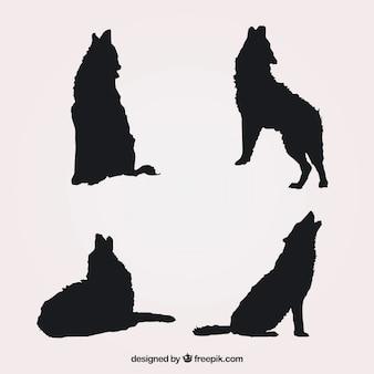 Packung von vier silhouetten von wölfen