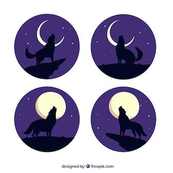 Packung von vier wölfen heulen auf dem mond