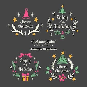 Packung von weihnachten abzeichen auf blackboard-effekt