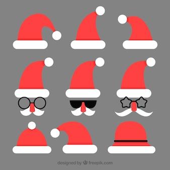 Packung weihnachtsmützen im flachen design