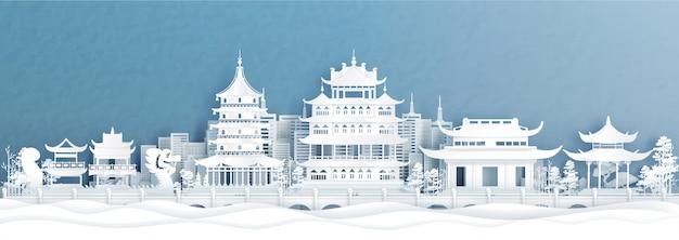 Panoramaansicht von hangzhou, china-stadtskylinen in der papierschnittart-vektorillustration.