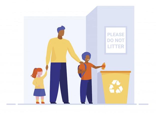Papa mit kindern, die müll in den papierkorb werfen