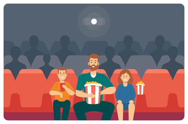 Papa mit kindern im kino. junger vater, tochter und sohn genießen film im kino. fröhliches familien-charakter-wochenende