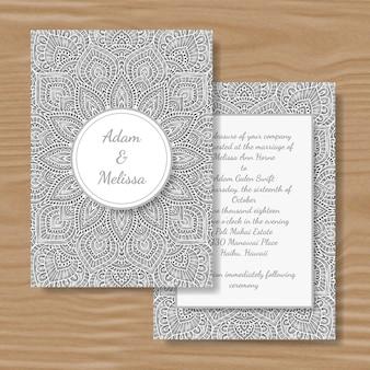 Papier geschnittene weiße mandalahochzeitskarte.