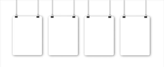 Papierbogen mit schatten im format und schwarzer büroklammer