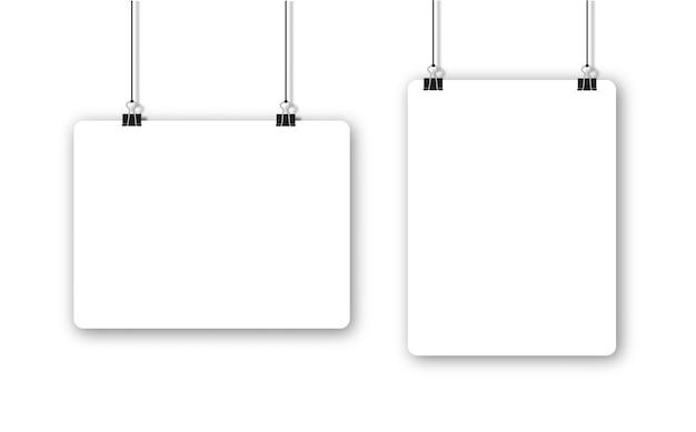 Papierbogen mit schatten im format und schwarzer büroklammer Premium Vektoren