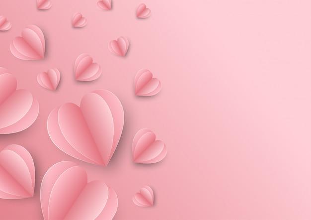 Papierelemente in form des herzens auf rosa
