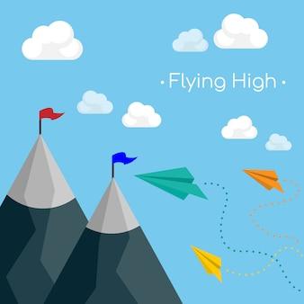 Papierflugzeug fliegt über berge