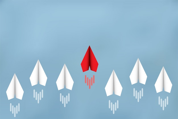 Papierflugzeuge konkurrieren mit zielen. führung. geschäftsfinanzkonzepte konkurrieren um erfolg und unternehmensziele. es gibt einen starken wettbewerb. anlaufen