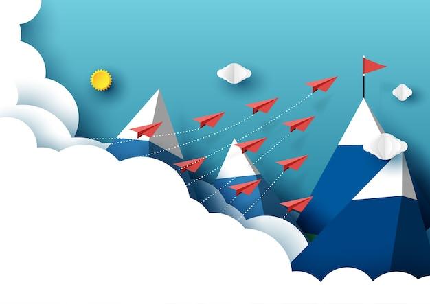 Papierflugzeugteamwork, das von der wolke zur roten flagge fliegt.