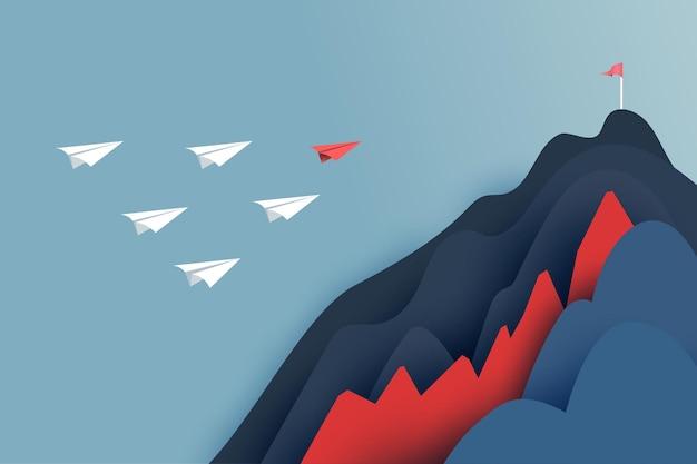 Papierführerflugzeug fliegt über hindernis zum ziel der roten flagge auf bergen. erfolgreiches und geschäftliches teamwork-konzept. papierkunst-vektorillustration.
